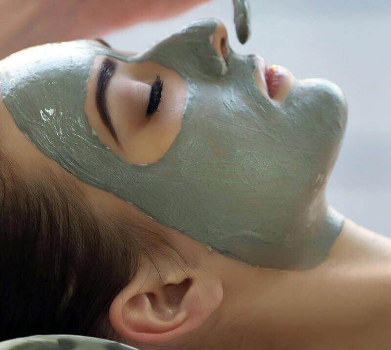 A lady enjoying a facepack treatment at Lingfield Park Resort
