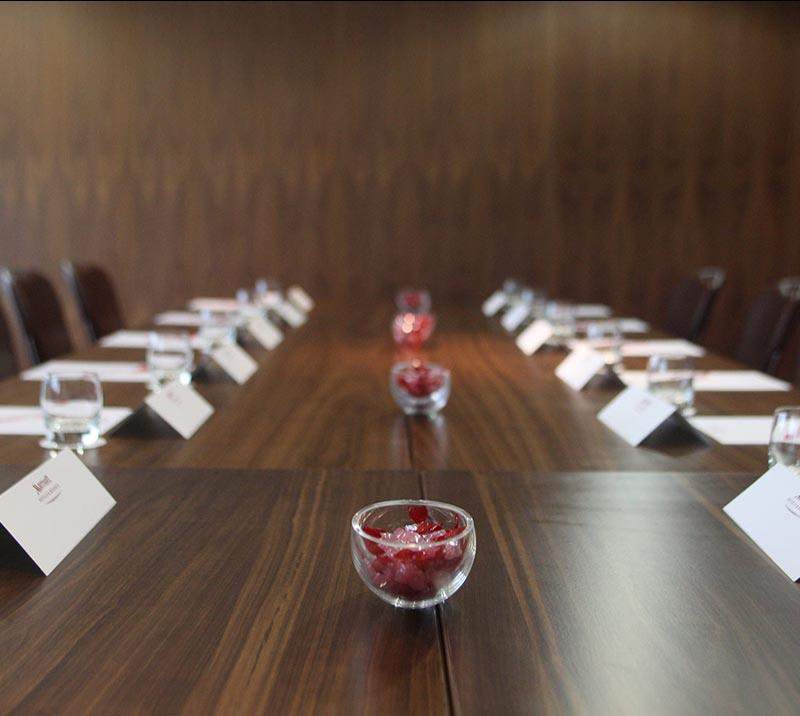 Close up of a table in boardroom.