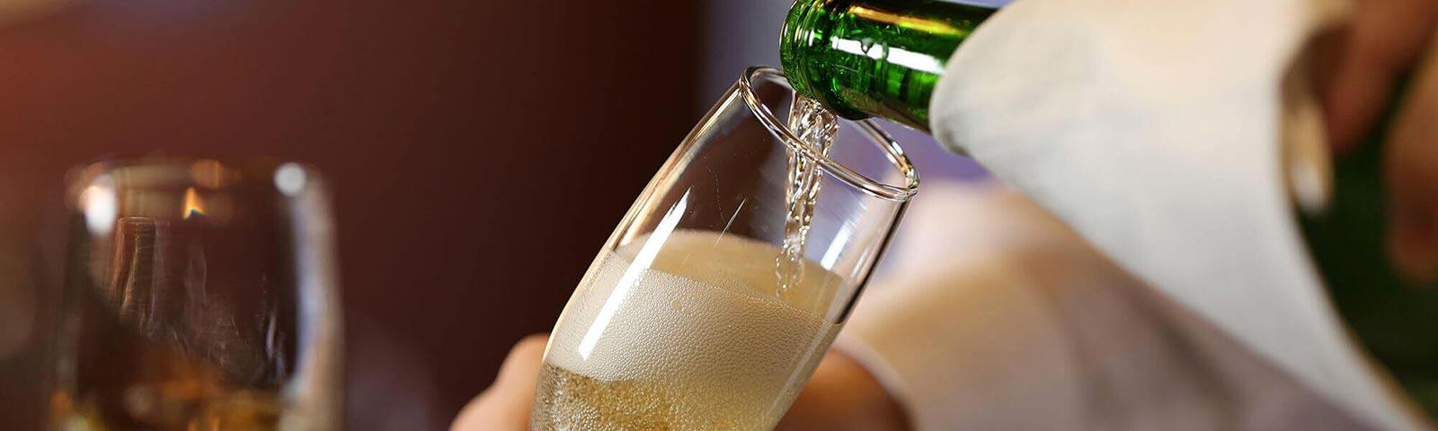 Champagne poured into a glass flute.